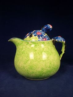 An Art Deco 1930's Clarice Cliff Bizarre Small Teapot, in 'Marguerite' Pattern