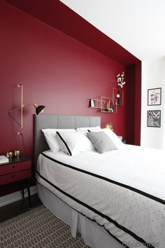 Burgundy red wall in a bedroom with brass wall lamp and brass shelve/ Mur chambre rouge avec luminaire et tagre en laiton et noir Red Bedroom Walls, Bedroom Wall Colors, Shelves In Bedroom, Accent Wall Bedroom, Bedroom Color Schemes, Red Walls, Bedroom Lamps, Master Bedroom, Burgundy Bedroom
