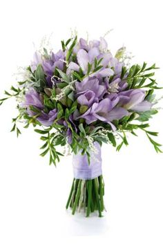 Hand-tied bouquet of freesias and eucalyptus