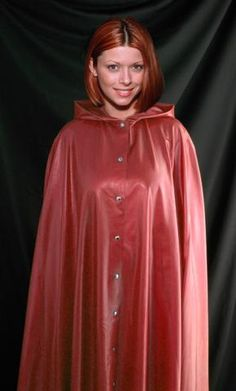 Red hair and a beautiful red latex rain cape. What could be more lovely on a wet rainy day?