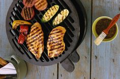 A lemon and Greek yogurt marinade keeps grilled chicken tender and moist as it delivers a subtle tang to the flavor.