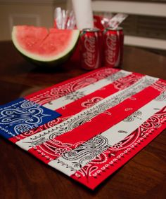 Bandanna placemat.  Glue white bandanna to plain cloth placemat, cut up blue and red bandannas to make flag.