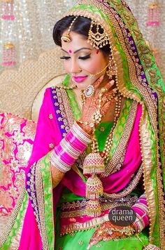Indian bride wearing bridal lehenga and jewelry. Sikh wedding dress, bright and colorful wedding lehenga Indian Wedding Fashion, Indian Bridal Wear, Asian Bridal, Sikh Wedding, Indian Wedding Outfits, Pakistani Bridal, Bridal Outfits, Indian Wear, Indian Outfits
