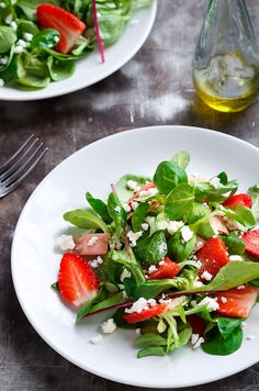 A delicious lamb lettuce salad overflowing with fresh strawberries, feta cheese, tangy rhubarb and a simple olive oil dressing.