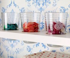 Notice how the glass is set into a hole in a 2x4? love that part!  Color Coordinated  Beverage glasses aren't just for lemonade. Use clear glass or plastic glasses to store small supplies, including buttons, rickrack, and other embellishments. You'll be able to quickly identify what's available, plus give your crafts space a pleasing ambience.