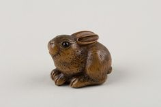 Netsuke of a Seated Hare ( late 18th–early 19th century) by Minkō (Japanese, circa 1735–1816). Wood, horn. Image and text courtesy The Met.