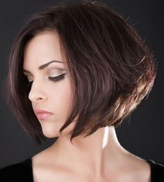 This brunette bob has a bouncy feel to it, especially at the bottom. For a haircut with tons of volume around your face, this one will do the trick.