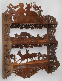 +++++++++++DANNY GUESS  Black Forest cutout three tier shelf depicting Diana and animals