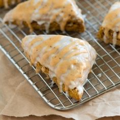 Spiced Pumpkin Scones - You can buy Starbucks pumpkin scones! Yep, they're good — heavily spiced, perfect with coffee and the prettiest orange color. Just perfect for when you're all caught up with fall. Within days of biting into our first Starbucks pumpkin scones, we were determined to make our very own at home. We, of course, took a few liberties, but these pumpkin scones are pretty darn close.