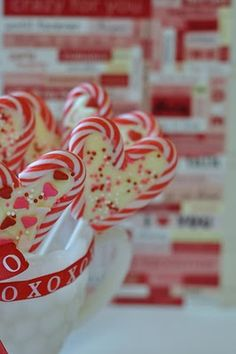 Lay your Mini Candy Canes on wax paper in the shape of a heart and a Cookie Treat Stick midway into the heart shape.     Melt some White Chocolate or White Chocolate Chips or Wilton Holiday Candy Melts in a Zip Lock baggie (i used a quart size freezer bag, they're heavier) in the Micro-wave. (zap for about 1 minute,