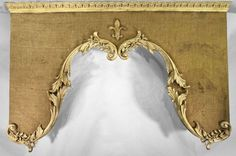 Parisian Cornice: antiqued with authentic French embellishments. We can upholster with your fabric also.