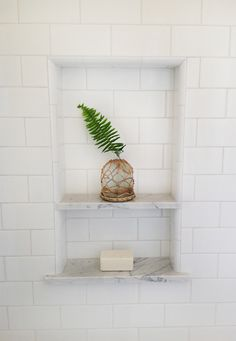 Shower niche - white subway with marble shelves