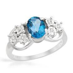 Ring With Diamonds  And Topaz - Size 7  Wonderful ring with genuine diamonds and topaz well made in 925 sterling silver. Total item weight 3.4g. Gemstone info: 6 diamonds, 0.03ctw., with round shape and accent color. Clarity: ACCENT. 1 topaz, 1.43ctw., with square shape and light blue color.