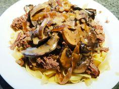 Shredded Pot Roast on Noodles with Mushroom Sauce.