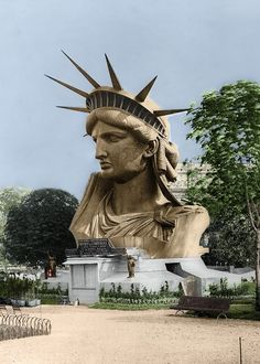 A colorized photo of the head of the Statue of Liberty, as displayed at the Paris World Fair in 1878.