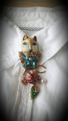 Vintage cat brooch, cat pendant, costume jewelry, eclectic, complete with charms: horseshoe, flower, grapes, marbled bead, faux pearl by TheYoungAntiquers on Etsy