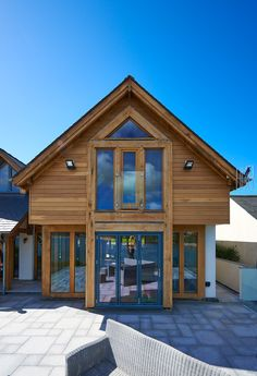 This oak home blends contemporary details, such as the straight-edge timber cladding and long run of bi-fold doors, with characterful oak frame construction techniques.