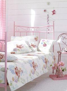 Pretty pink bed with vintage linen