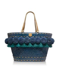 Beachy Norah Bucket Tote | Womens Sale | ToryBurch.com $197.50. Inspired by the spirit and color of the Mediterranean coast, our Beachy Norah Bucket Tote combines a playful mix of textures — woven raffia, pom-poms and fringe — with brilliant saturated hues. It's a statement piece on its own, but even better when matched with the season's eclectic mix of patterned, eyelet and embellished pieces.