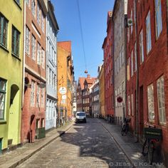 When you visit Copenhagen's city center, be sure to take a walk down the cosy side streets on both sides of Strøget. This photo is taken on Magstræde, a narrow street with old, colorful buildings (Copenhagen, Denmark, København, Danmark, Europe, European)