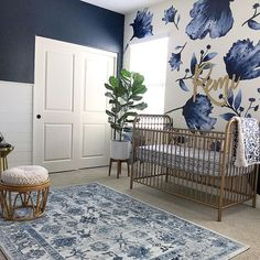 My Top Posts & Favorite Nursery Trends of 2018 2019 This navy nursery is gorgeous with that floral wallpaper and brass / gold accents. The post My Top Posts & Favorite Nursery Trends of 2018 2019 appeared first on Nursery Diy. Navy Nursery, Nursery Room, Floral Nursery, Blue Nursery Girl, Accent Wall Nursery, Nursery Modern, Rustic Nursery, Wall Paper Nursery, Vintage Nursery