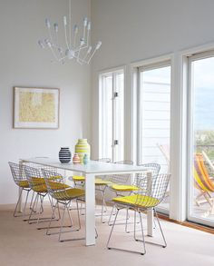 Love everything about this...the view, the chairs, table, light fixture, decor...yellow n white