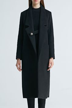 long black topcoat. Love that button tab closure!