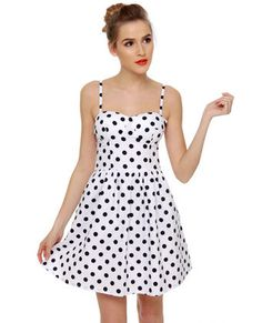 "Cute white dress with black polka dots. Adjustable/removable straps-- length from bust to hem is 26"". Full skirt, slightly sheer, fully lined, padded bust. $32."