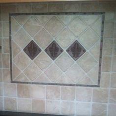 Fleur de Lis kitchen backsplash (copper accents) and tumbled marble tiles.  MY kitchen