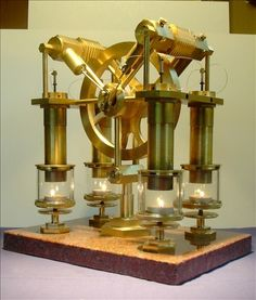 gorgeous brass Stirling engine powered by four tea lights