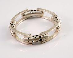 Bracelet |  Designer Unknown.  Sterling silver modernist bracelet