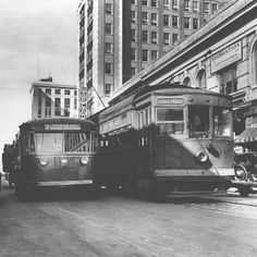 """This photo, taken in 1936 on Forsyth near Main in downtown Jacksonville captures the meeting of old and new transit systems. According to FDOT, """"One by one the 'Motor Transit Company' replaced the electric trolley cars. From February 28, 1933 until 1936, only the Kings Road and la Villa lines ran, and then only during rush hours. Jacksonville soon became the nation's largest city with no rail transit."""""""