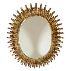 Modernist Mid-Century Double Ray Sunburst Gilt Metal Mirror | From a unique collection of antique and modern wall mirrors at http://www.1stdibs.com/furniture/mirrors/wall-mirrors/