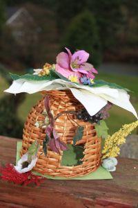 Fairy house.  Upside down basket, flowers, etc.