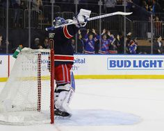 NEW YORK, NY - FEBRUARY 11: Henrik Lundqvist #30 of the New York Rangers celebrates an empty net goal by Kevin Hayes #13 against the Colorado Avalanche at Madison Square Garden on February 11, 2017 in New York City. With the win, Lundvist recorded his 400th NHL victory. The Rangers defeated the Avalanche 4-2. (Photo by Bruce Bennett/Getty Images)
