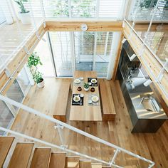 This wooden home is beautiful. The eaves, the light wood and the white create a beautiful space. 木の家 | 無印良品の家