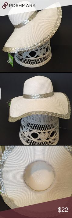 """🆕 White wide brimmed woven casual/beach hat Beautiful white woven hat with silver trim around brim and crown. Perfect for  any occasion as well as for the beach! Wide brim is 5.5"""" all around, crown is 7.5"""", diameter 18"""". Kelly & Katie Accessories Hats"""