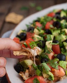 This Mexican bean dip is easy and tasty as can be with Greek yogurt adding a nutrition and protein punch. The melted cheese and toppings take it over the top! -Feasting Not Fasting