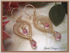 These frilly and feminine beauties were made with 14k gold-filled wire. Each frame was shaped and hammered for strength, and then coiled and woven into shape. For the gems, I chose these gorgeous, top quality pink topaz teardrop briolettes.   Each earring hangs from a handcrafted and secure ear-wire which has been embellished with a shimmering stardust bead. You get the look and feel of a hook ear-wire without the worry of losing an earring.  All metals are 14k gold-filled.  Measurement: 2…