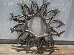 To make in memory of Pop-pop and uncle Hugh. Now I just need 12-13 horseshoes. @.Sara Renzulli: Sarafina Fiber Art