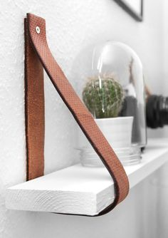 PIN 1 Great way of making a simple shelf look amazing by using leather.