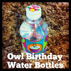 Owl Birthday Party Water Bottles- inexpensive way to add a festive touch to Owl birthday party using patterned duct tape and owl stickers.