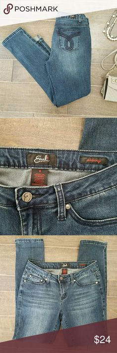 """Earl Jeans Skinny Denim Earl Jeans skinny blue jeans. Mid-rise denim. 29"""" inseam. 9"""" rise. Designed back pockets w/ navy stitching. Slight whiskered fading on front. Size 6. Cute cuffed or uncuffed!  Cotton with a bit of polyester and spandex, so there is some stretch.   Peace & Happy Poshing! Earl Jeans Jeans Skinny"""