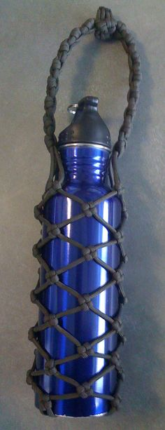 "Paracord water bottle holder: Using a modified Chinese Good luck knot and a Cross Knot. You will need the following:  -An aluminum water bottle -Four  stands of paracord each measuring 112"" inches (448"" total) or shorter depending on what you do at step 6. -A lighter (for melting the ends of the paracords closed) -Scissors or knife -About 4-6 Hours"