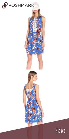 Kensie Japanese Garden Dress, Size Medium This dress is a stunner! It's a perfect shade of blue with a gorgeous floral pattern for the spring and summer, is very lightweight, and has an easy fit and flare silhouette. The lace across the open back is a great detail. This dress is brand new in its shipping bag- I accidentally ordered two. I've worn mine a ton- great for bridal/baby showers, weddings, fancy date night, you name it! Kensie Dresses Mini