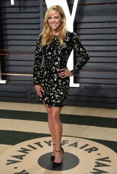 Reese Witherspoon arrives at the Vanity Fair Oscar party on Sunday, Feb. 26, 2017, in Beverly Hills, Calif. Witherspoon went short for the party, wearing a Michael Kors Collection dress, Christian Louboutin heels and Tiffany and Co. jewelry.