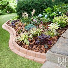 curvy brick border plants flowers bed garden landscaping