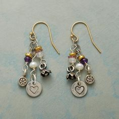 """SHOWERED WITH LOVE EARRINGS -- In our handcrafted 'Showered With Love' mixed gemstone earrings, amethyst, moonstone, pink tourmaline and cultured freshwater pearl with Thai silver charms fall from twisted sterling silver in our handcrafted earrings. 14kt gold filled wires. USA. Exclusive. 1-5/8""""L."""