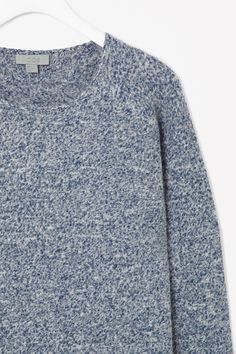 BOILED WOOL JUMPER  This jumper is made from boiled wool for a modern structured shape and speckled melange finish. A relaxed fit with oversized proportions, it has long raglan sleeves and clean, modern edges.