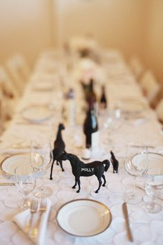 For a Kentucky derby party!! Chalkboard paint cheap plastic horses, write the name of the person and put at their seat